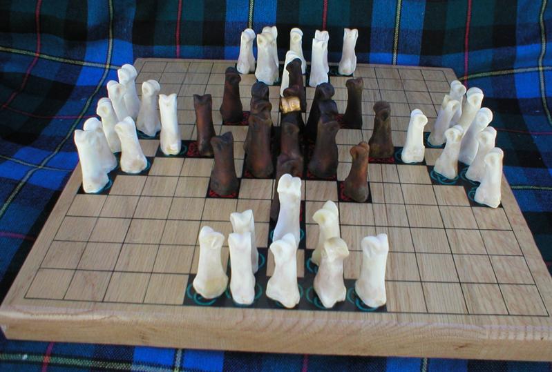 A Hnefatafl Game I made using deer toe bones as the pieces.